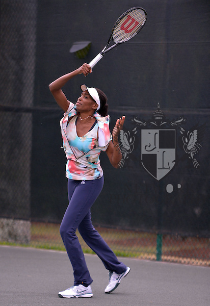 PINECREST, FL - MARCH 18: Venus Williams visit First Serve Miami (FSM) to personally meet with and lend her support by offering valued life skills to at risk kids. Venus brought her tennis racquet and gives professional tennis tips to the kids who are all learning how to play tennis at Royal Palm Tennis Club, Florida on March 18, 2013 in Pinecrest, Florida. (Photo by Johnny Louis/jlnphotography.com)