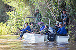 20 October 2013, Pakse, Laos:  Thai divers during a break from rescue and recovery efforts on the Sedon River  following a crash of a Lao Airlines plane into the river at Pakse, Laos. The aircraft crashed into the Mekong River tributary on approach to Pakse airport from Vientiane in severe weather killing all 44 passengers and 5 crew on board. Rescue workers are still dragging the fast flowing river for further remains and the main body of the plane.  Picture by Graham Crouch