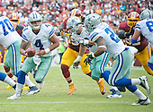 Dallas Cowboys quarterback Dak Prescott (4) looks to hand-off to Dallas Cowboys running back Ezekiel Elliott (21) in fourth quarter action against the Washington Redskins at FedEx Field in Landover, Maryland on Sunday, September 18, 2016.  The Cowboys won the game 27 - 23.<br /> Credit: Ron Sachs / CNP