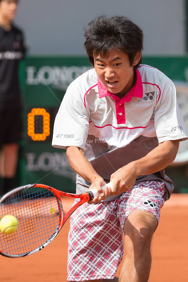May 25, 2015: Yoshihito Nishioka (JPN) in action in a 1st round match against  Tomas Berdych (CZE) on day two of the 2015 French Open tennis tournament at Roland Garros in Paris, France. Sydney Low/AsteriskImages