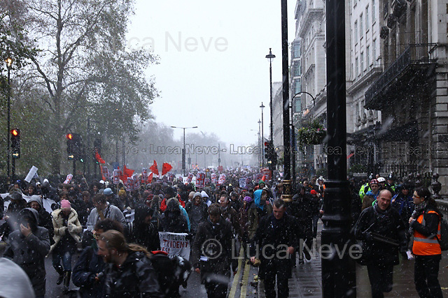London, 30/11/2010. Student demonstration against fees and cuts which started from Trafalgar Square and travelled across a snowy London to end back in Trafalgar Square where the police officers made a kettle to contain them. A number of protesters were arrested.