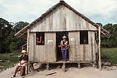 Xapuri, Acre State, Brazil. Rubber tapper at the door of his house holding a rifle, ready to defend his family.