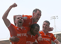 Blackpool's Nathan Delfouneso is swamped by with team-mates as he celebrates scoring his side's second goal <br /> <br /> Photographer Stephen White/CameraSport<br /> <br /> The EFL Sky Bet League One - Blackpool v Fleetwood Town - Monday 22nd April 2019 - Bloomfield Road - Blackpool<br /> <br /> World Copyright © 2019 CameraSport. All rights reserved. 43 Linden Ave. Countesthorpe. Leicester. England. LE8 5PG - Tel: +44 (0) 116 277 4147 - admin@camerasport.com - www.camerasport.com