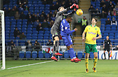 1st December 2017, Cardiff City Stadium, Cardiff, Wales; EFL Championship Football, Cardiff City versus Norwich City; Angus Gunn of Norwich City gets up over Junior Hoilett of Cardiff City to punch the ball away from danger