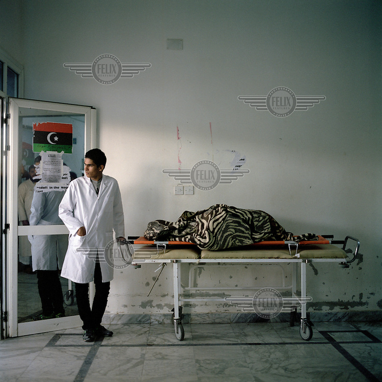 A young doctor in Ajdabiya hospital minds the severed body of a rebel fighter. On 17 February 2011 Libya saw the beginnings of a revolution against the 41 year regime of Col Muammar Gaddafi.