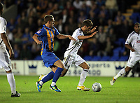 Pictured: Andrea Orlandi of Swansea (R) closely marked by Nicky Wroe of Shrewsbury (L). Tuesday 23 August 2011<br />