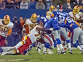 Washington Redskins defensive end Bruce Smith (78) sacks New York Giants quarterback Kerry Collins for an eight yard loss in the first quarter of the game at Giants Stadium in East Rutherford, New Jersey on September 24, 2000.  Redskins linebackers Derek Smith (50) and Reggie Givens (58) join the pursuit.  The Redskins won the game 16 - 6.<br /> Credit: Arnie Sachs / CNP