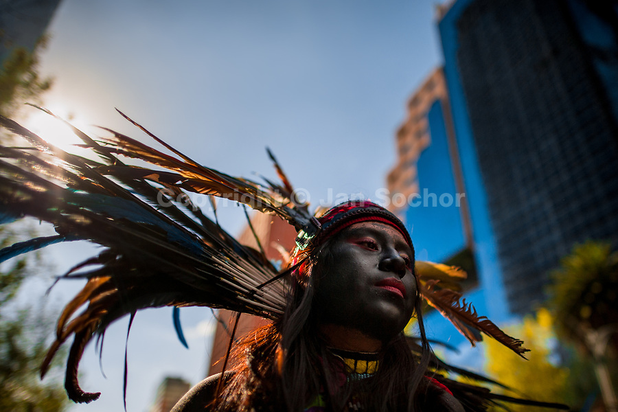 A Mexican girl, wearing a colorful feather headgear inspired by Aztecs, takes part in the Day of the Dead procession in Mexico City, Mexico, 29 October 2016. Day of the Dead (Día de Muertos), a syncretic religious holiday combining the death veneration rituals of the ancient Aztec culture with the Catholic practice, is celebrated throughout all Mexico. Based on the belief that the souls of the departed may come back to this world on that day, people gather at the gravesites in cemeteries praying, drinking and playing music, to joyfully remember friends or family members who have died and to support their souls on the spiritual journey.