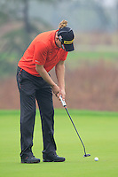 Marcel Siem (GER) putts on the 14th green during Friday's Round 2 of the 2014 BMW Masters held at Lake Malaren, Shanghai, China 31st October 2014.<br /> Picture: Eoin Clarke www.golffile.ie