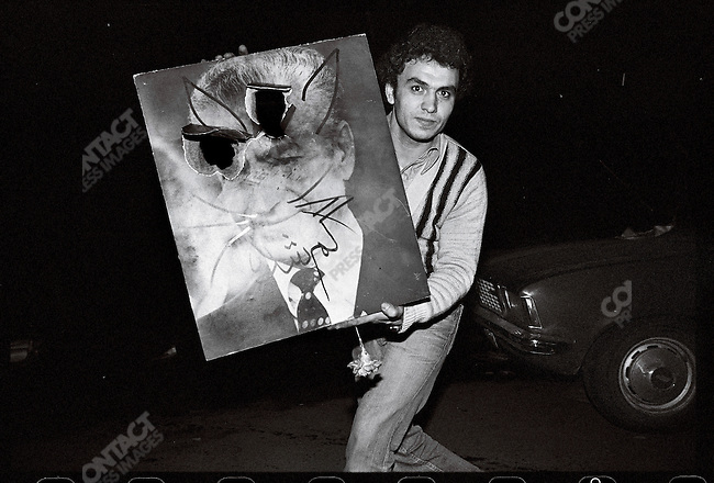 """Scenes of celebration after the departure of the shah. The shah is depicted as a cat because the French for """"cat"""" (chat) sounds like """"shah."""" Tehran, January 16, 1979."""