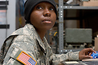 Private First Class Stephanie Sigler, 26 years old from Sunter South Carolina and with Echo Company, 1st Battalion, 506th, 101st airborne Division performs her duties at the battalion maintenance office located at Combat Outpost ( C.O.P.), Eastern Ramadi, Al Anbar Province, Iraq on Thursday JAN 12 2006. She is separated and her son is waiting for her at home with her parents. During her free time she    buys him gifts and all his necessities on the internet.