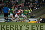 Brendan O'Sullivan and Mark Griffin South Kerry in action against Dara O'Sullivan Dingle in the Quarter Final of the Kerry Senior County Championship at Austin Stack Park on Sunday.