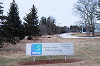 """A sign reading """"AMSC / Smarter, cleaner ... better energy"""" stands outside the old headquarters of AMSC, also known as American Superconductor, in Devens, Massachusetts, USA, seen on Tues., Jan. 30, 2018. AMSC was the victim of the theft of trade secrets, starting in 2011 when the Chinese company Sinovel worked to steal and modify AMSC's proprietary wind turbine-running software. Sinovel was AMSC's largest customer, and McGahn estimates that 70% of China's wind turbines now run software stolen from AMSC. AMSC has received favorable judgments from American and Chinese courts, and the company contends that it is owed billions of dollars as a result of the theft, which almost destroyed the company. When news of the theft came out, the company's stock value decreased substantially and went from approximately 800 employees to fewer than 200. The company has rebounded some since the crime."""