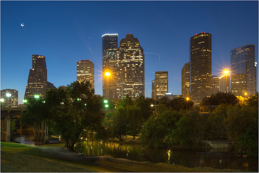 On a very early morning near the Sabine Street Bridge, this image from the largest city in Texas shows the Houston skyline as it awakens before sunrise. The crescent moon was rising about 40 minutes before first light and seemed to hover over the downtown area. Beneath the city lights, Buffalo Bayou flows slowly through the greenbelt along Allen Parkway. This skyline image is available as a digital file or as a fine art print.