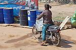 Woman Transporting Ice On Motor Bike
