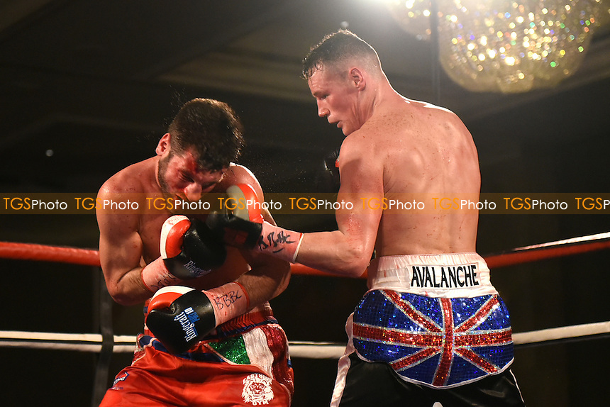 Alan Higgins (black shorts) defeats Cello Renda to win the Southern Area Super-Middleweight Title during a Boxing Show at the Hilton Hotel on 2nd December 2016