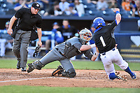 Tennessee Volunteers catcher Sean Skelly (44) tags out a hard sliding Lucas Owens (1) as home plate umpire Darrell Arnold prepares to make a call during a game against the UNC Asheville Bulldogs at McCormick Field on March 15, 2016 in Asheville, North Carolina. The Volunteers defeated the Bull Dogs 7-3. (Tony Farlow/Four Seam Images)