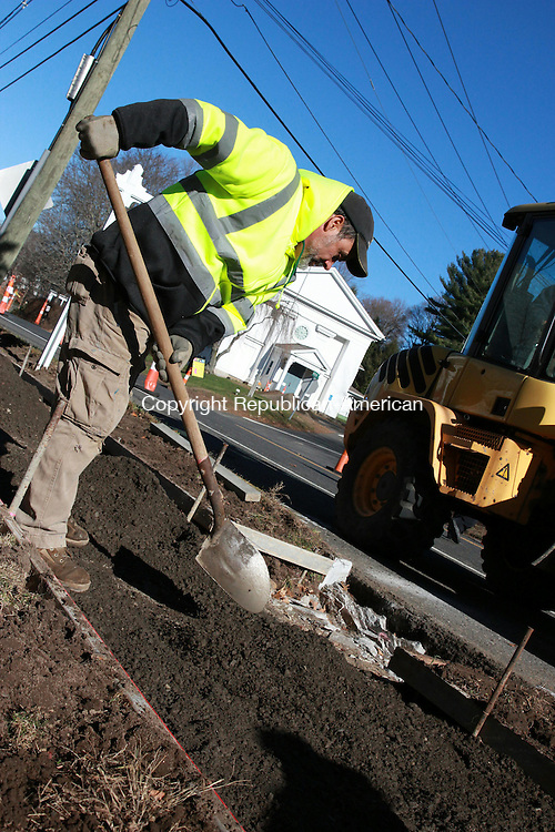 WOODBURY, CT: 23 Nov. 2015: 231115CB02: WOODBURY -- Rui Paz, with Complete Construction, works to lengthen a sidewalk on Main Street, part of a project to move a pedestrian crosswalk. The current crosswalk location, near the intersection of Main Street and Judson Avenue, is considered unsafe by officials. Public Works Director Rich Lamothe said the project's contractor expects work to be completed within a few weeks. Caleb Bedillion Republican-American
