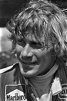 ANDERSTORP, SWEDEN - JUNE 13: James Hunt of Great Britain waits to drive his McLaren M23 8-2/Ford Cosworth during practice for the Grand Prix of Sweden FIA Formula 1 race at Scandinavian Raceway near Anterstorp, Sweden, on June 13, 1976..