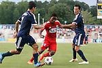 09 July 2014: Dallas' Fabian Castillo (COL) (center) is defended by Carolina's Cesar Elizondo (CRC) (7) and Kupono Low (3). The Carolina RailHawks of the North American Soccer League played FC Dallas of Major League Soccer at WakeMed Stadium in Cary, North Carolina in the quarterfinals of the 2014 Lamar Hunt U.S. Open Cup soccer tournament. FC Dallas won the game 5-2.