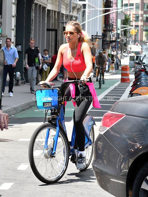 www.acepixs.com<br /> <br /> August 3 2016, New York City<br /> <br /> Singer Rita Ora takes a spin around Soho on a Citibike on August 3 2016 in New York City<br /> <br /> By Line: Curtis Means/ACE Pictures<br /> <br /> <br /> ACE Pictures Inc<br /> Tel: 6467670430<br /> Email: info@acepixs.com<br /> www.acepixs.com