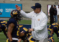 California head coach Jeff Tedford shakes hands with Marc Anthony of California during warm up before 115th Big Game at Memorial Stadium in Berkeley, California on October 20th, 2012.  Stanford defeated California, 21-3.