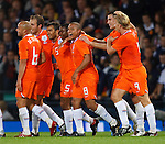 Holland celebrate after Eljero Elia's goal