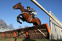 Race winner Black Dragon ridden by Matt Crawley in jumping action during the Wensum Handicap Hurdle