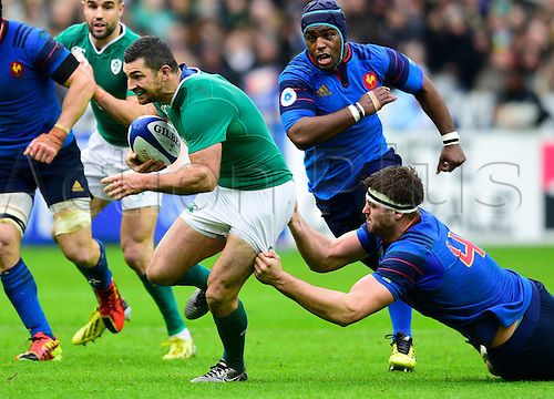 13.02.2016. Stade de France, Paris, France. 6 Nations Rugby international. France versus Ireland.  Rob Kearney ( Ireland ) tries to outstep the tackle from Alexandre Flanquart ( France )