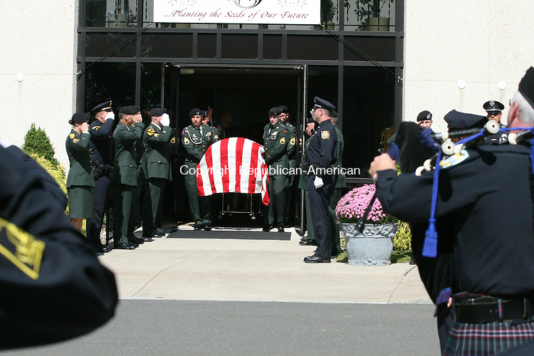 BLOOMFIELD, CT - 19 September, 2008 - 091908MO10 - Pallbearers from the Connecticut Army National Guard lift the casket of Sgt. 1st Class (and Winsted Patrolman) David F. Rosati Friday. His funeral was held at Sacred Heart Church in Bloomfield, followed by a burial with full military honors in Mountain View Cemetery. Rosati, decorated as both a soldier and police officer, died Tuesday after a long battle with cancer. He was 48.  Jim Moore Republican-American.