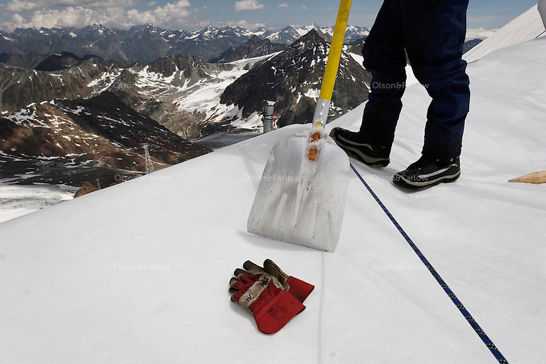 "Brunnenkogel Ferner (Austrian word for glacier) is wrapped with a fleece-like cover to keep it from melting.  Workers uncovered rolls of the material and attached it to the top of the part of the glacier.  Covered ice melts slower. <br /> The ski area at 3,400 meters is covered to help save the ski industry since the glacier is retreating.  The cost of materials is one Euro per square meter.<br /> <br /> The Alpine glaciers -- in Austria, Switzerland, France and Italy -- are losing one percent of their mass every year and, even supposing no acceleration in that rate, will have all but disappeared by the end of the century. More hot, dry summers like that of 2003 in Europe, when the loss speeded to five percent, could cut the life expectancy to no more than 50 years, according to Wilfried Haeberli of the University of Zurich...""We estimate that by the end of the 21st century, with a medium-type climate scenario, about five percent of what existed in the 1970s will have survived, he added."