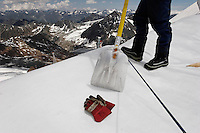 Brunnenkogel Ferner (Austrian word for glacier) is wrapped with a fleece-like cover to keep it from melting.  Workers uncovered rolls of the material and attached it to the top of the part of the glacier.  Covered ice melts slower. <br /> The ski area at 3,400 meters is covered to help save the ski industry since the glacier is retreating.  The cost of materials is one Euro per square meter.<br /> <br /> The Alpine glaciers -- in Austria, Switzerland, France and Italy -- are losing one percent of their mass every year and, even supposing no acceleration in that rate, will have all but disappeared by the end of the century. More hot, dry summers like that of 2003 in Europe, when the loss speeded to five percent, could cut the life expectancy to no more than 50 years, according to Wilfried Haeberli of the University of Zurich...&quot;We estimate that by the end of the 21st century, with a medium-type climate scenario, about five percent of what existed in the 1970s will have survived, he added.