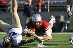 Jeff Tuel (#10), Washington State quarterback, dives for more yardage during the Cougars 23-22 comeback victory over Montana State at Martin Stadium on the WSU campus on September 11, 2010.