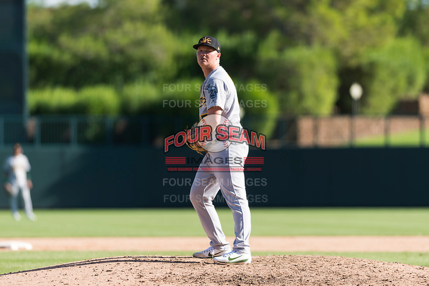 Mesa Solar Sox relief pitcher Jake Bray (15), of the Oakland Athletics organization, gets ready to deliver a pitch during an Arizona Fall League game against the Glendale Desert Dogs at Camelback Ranch on October 15, 2018 in Glendale, Arizona. Mesa defeated Glendale 8-0. (Zachary Lucy/Four Seam Images)
