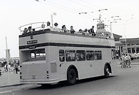 BNPS.co.uk (01202 558833)<br /> Pic: BearCrossBusCo/BNPS <br /> <br /> Back in the day - The vintage bus near Bournemouth pier in the 1970's.<br /> <br /> A small group of volunteers have reintroduced a historic seaside bus service after spending five years restoring the original bus that travelled the route 50 years ago.<br /> <br /> The classic yellow open top 1965 Daimler Fleetline double decker is back running the old 'Route 12'  service between Bournemouth and Hengistbury Head.<br /> <br /> The volunteers drive and conduct the bus, as well as maintaining it and producing the timetables and bus stop flags.<br /> <br /> The vintage Bournemouth Corporation Transport bus ran along the idyllic five mile stretch of Dorset coastline from 1965 to 1977.<br /> <br /> But it had fallen into a 'sorry state' and was languishing in a depot when it was purchased by the volunteers from a bus operator in Purfleet, Essex, for £2,000 in 2014.