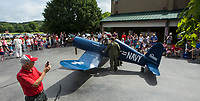NWA Democrat-Gazette/BEN GOFF @NWABENGOFF<br /> Michael Hull (left) and brother Andrew Hull of Bella Vista push float they made of a 1/2 scale Vought F4U Corsair Thursday, July 4, 2019, during the Bella Vista Patriots Parade at Sugar Creek Shopping Center.