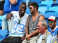 Enoch Balotelli (left), the brother of Mario Balotelli of Italy, watches from the crowd before kick off