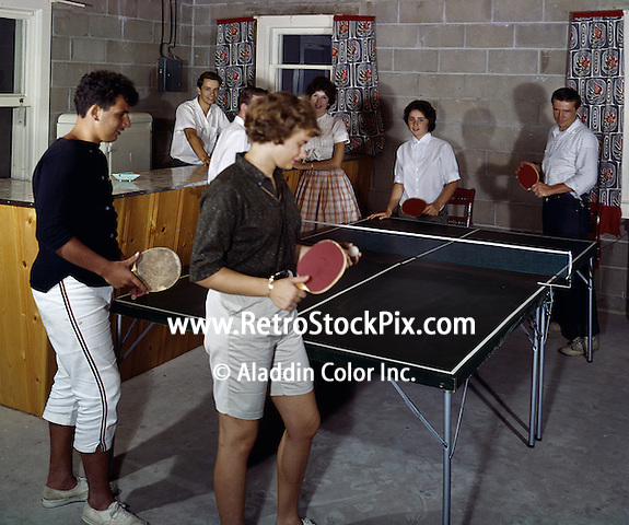 Young couples playing ping pong.