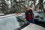December 16, 2010. Raleigh, NC.. TP Mishra locks his car after dropping his roommate off at work. Mr Mishra has been driving for just over a month. One of the biggest changes between New York City and North Carolina has been learning to drive and navigate the city by car.. TP Mishra, a refugee from Bhutan, has recently relocated from the Bronx to Raleigh, where he lives in an suburban apartment  with his wife, as well as another Bhutanese couple.