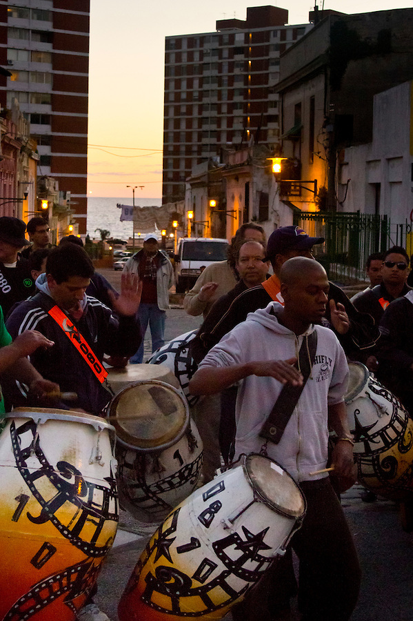 Candombe comparsa Cuareim 1080 preparing for practice on peatonal Curuguaty in the Barrio Sur neighborhood of Montevideo, Uruguay.