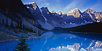 Banff National Park, Alberta, Canada<br /> Morning sun on Wenkchemna Peaks with reflections on blue waters of Moraine Lake - Valley of Ten Peaks