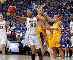 SIOUX FALLS, SD: MARCH 6: Mikale Rogers #33 from IUPUI grabs a rebound in front of Clarissa Ober #21 from South Dakota State during the Summit League Basketball Championship on March 6, 2017 at the Denny Sanford Premier Center in Sioux Falls, SD. (Photo by Dave Eggen/Inertia)