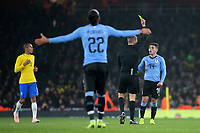 Lucas Torreira of Uruguay is shown a yellow card after a foul on Neymar Jr during Brazil vs Uruguay, International Friendly Match Football at the Emirates Stadium on 16th November 2018