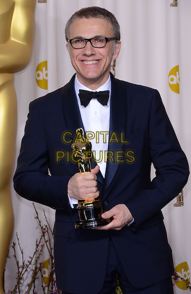 Christoph Waltz.85th Annual Academy Awards held at the Dolby Theatre at Hollywood & Highland Center, Hollywood, California, USA..February 24th, 2013.pressroom oscars half length black smiling tuxedo white glasses award trophy winner .CAP/ADM/RE.©Russ Elliot/AdMedia/Capital Pictures.