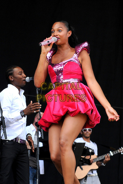 ALESHA DIXON.V Festival 2009 - Day Two,.Hylands Park, Chelmsford, Essex, UK.23rd August 2009..on stage music gig concert performing live half length pink sequined puffball hem dress shoulder pads sculpted microphone singing .CAP/BRC.©Ben Rector/Capital Pictures.