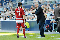Schellas Hyndman FC Dallas head coach gives sideline instructions to defender.Zach Loyd... Sporting KC defeated FC Dallas 2-1 at LIVESTRONG Sporting Park, Kansas City, Kansas.