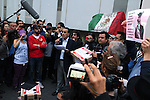 Mexican protesters stage a meeting in front of the MVS Radio venue to protest against the firing of radio journalist Carmen Aristegui in Mexico City, March 16, 2015. Journalists and editorial commentators have written on alleged influence decision made by the Pena Nieto regimen against the journalist who investigated the conflict of interest on President Pena's wife about her home known as the Casa Blanca. Photo by Heriberto Rodriguez