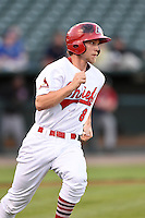 Peoria Chiefs designated hitter Steve Bean (8) runs to first during a game against the Kane County Cougars on June 2, 2014 at Dozer Park in Peoria, Illinois.  Peoria defeated Kane County 5-3.  (Mike Janes/Four Seam Images)