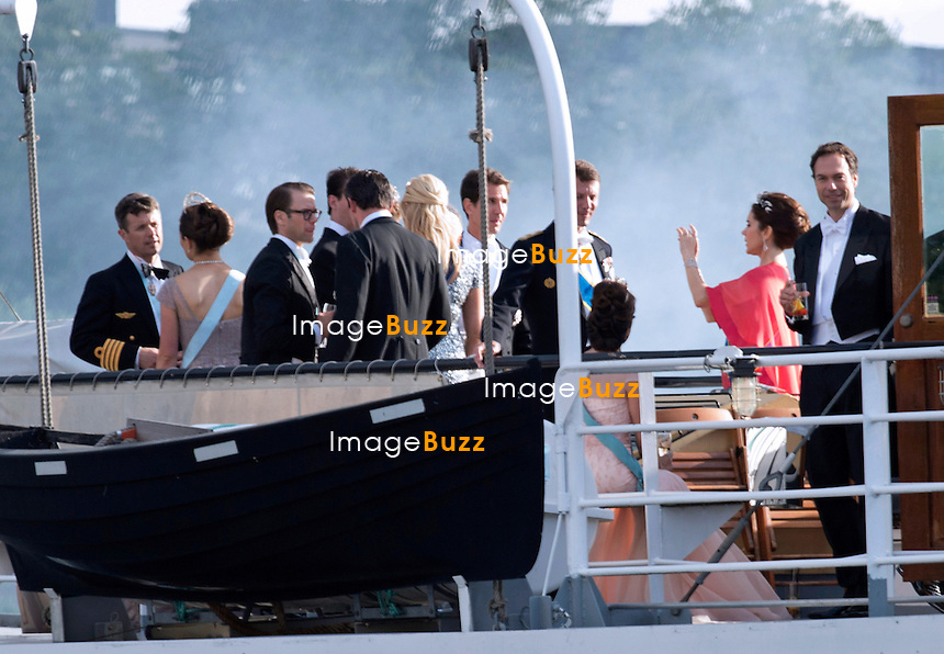 CROWN PRINCESS MARY CAPTURES IMAGES OF THE GUESTS<br /> on her mobile phoneas the boat departs for a boat ride to Drottingholm Palace for the Wedding Banquet Riddarholmen, Stockholm, Sweden_08/06/2013<br /> Princess Madeleine married Christopher O'Neill at the Royal Chapel, Royal Palace in Stockholm
