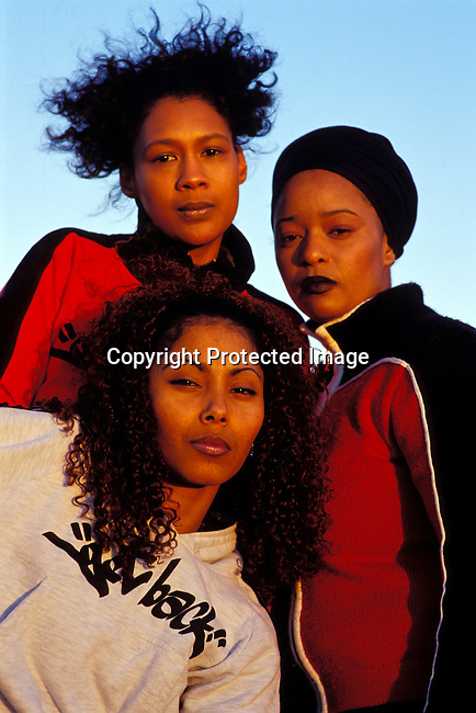 dimuhip00017 The all female hip-hop group Godessa on September 5, 2002 in downtown Cape Town, South Africa. .©Per-Anders Pettersson/iAfrika Photos